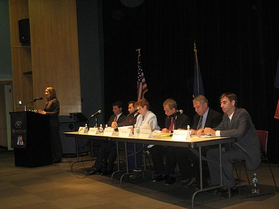 Moderator Grace Rauh and candidates (left to right) Doug Biviano, Evan Thies, Jo Anne Simon, Ken Baer, Ken Diamondstone, and Steve Levin. BHB photo by C. Scales.