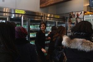 A Juice Press employee squeezes through crowds at the Brooklyn Heights Montague St. location.