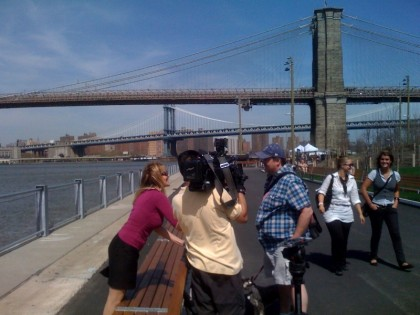 WPIX-TV's Monica Morales interviews a passerby at Brooklyn Bridge Park